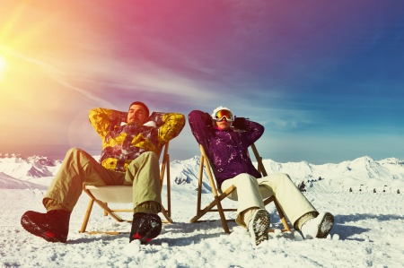 Couple at mountains in winter, Meribel, Alps, France