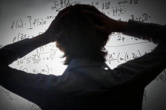 Student holding his head looking at complex math formulas on whiteboard. Problem to solve