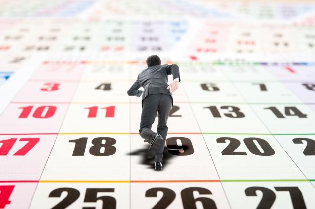 カレンダー,走るビジネスマン
