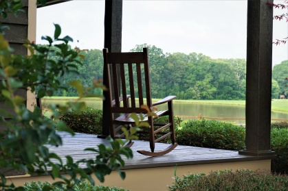 The wooden rocking chair at the beautiful view terrace is waiting for someone to relax on. GA USA